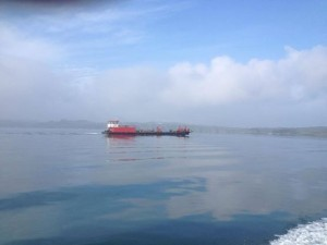 A beautiful morning once the fog lifted, as we pass the cargo barge to the Islands