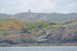 A big Éire sign and Spain tower on a hillside near Baltimore in West Cork