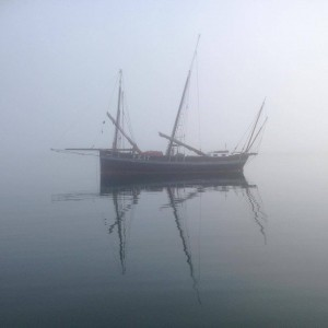 Sailing ship 'Peel Castle' appears out of the early morning fog