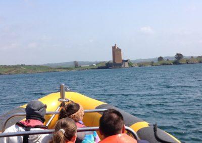 Passengers admiring Kilcoe Castle