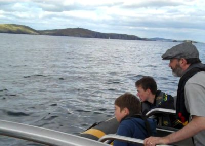 Comedian Tommy Tiernan dolphin watching with Ba